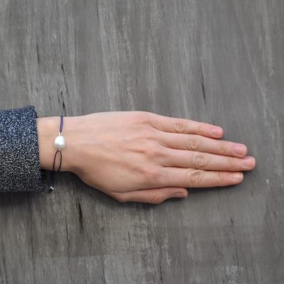 """Pearl bracelet -  - The """"Pearl"""" bracelet is a gorgeous, everyday piece. Easy to wear and perfect for any look! It will bring a happy note to your look while you are allowed to pick the cord color of your liking.  Material: Silver 925, pearl."""